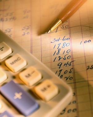 Pen, Calculator and Ledger
